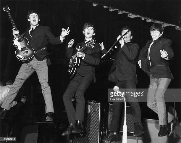 Paul McCartney George Harrison John Lennon and Ringo Starr jump for joy during a rehearsal for the Royal Command Performance at the Prince of Wales...