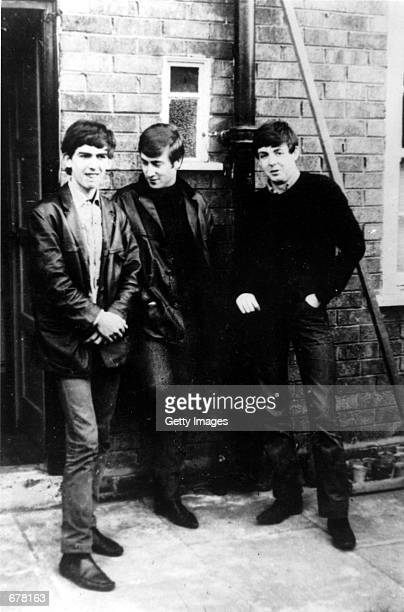 The Beatles George Harrison, John Lennon and Paul McCartney, stand outside McCartney's home January 1, 1960 in Liverpool, England. Ringo Starr was...