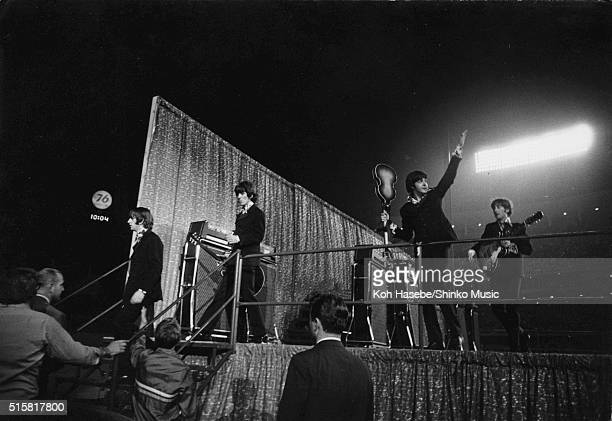 The Beatles getting off the stage and waving to the audience at Dodger Stadium Los Angeles California August 28 1966 LR Ringo Starr George Harrison...