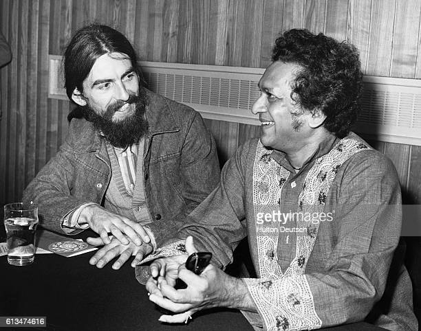 The Beatles guitarist George Harrison talks to Indian musician Ravi Shankar at the Royal Festival Hall during a break from rehearsals for the...