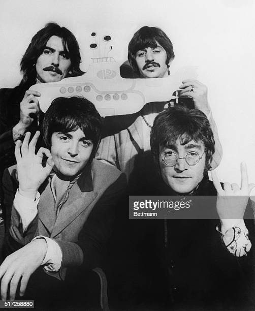 The Beatles hold a submarine during their announcement to make the animated film Yellow Submarine later released in 1968 From left to right George...