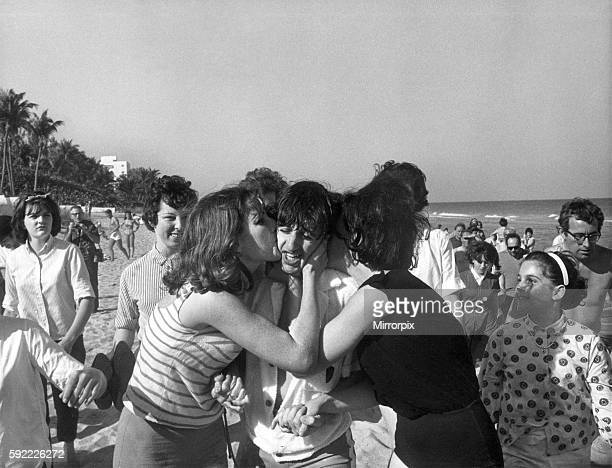 The Beatles in Miami Florida 18th February 1964 A kiss for Ringo two high school girls sieze him as ge ran up the beach smothered him with kisses...