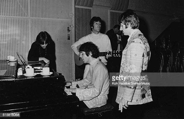 The Beatles in the studio during the recording session for the song Â'The Fool On The HillÂ' at EMI Studios Abbey Road London LR George Harrison Paul...