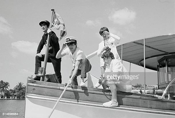 The Beatles John Lennon Paul McCartney George Harrison and Ringo Starr on the bow of a boat in Miami Beach