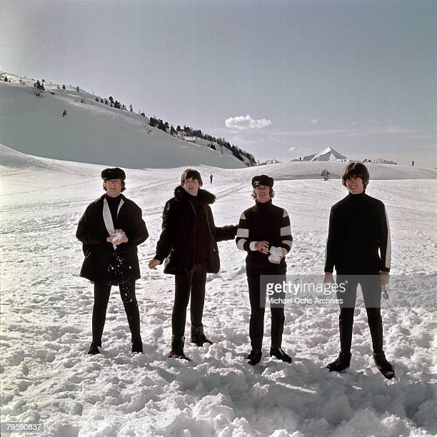 The Beatles John Lennon Paul McCartney Ringo Starr and George Harrison pose for a photo in the snow in March 1965 in Obertauern Austria during a...
