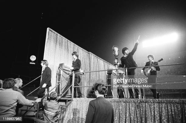 The Beatles leave the stage at the end of their show at the Dodger Stadium Los Angeles California United States on the band's final tour 28th August...
