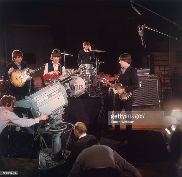 The Beatles left to right John Lennon Ringo Starr George Harrison and Paul McCartney being filmed for a promotional clip during the Abbey Road...