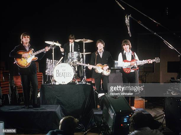 The Beatles left to right John Lennon Ringo Starr Paul McCartney and George Harrison being filmed for a promotional clip during the Abbey Road...