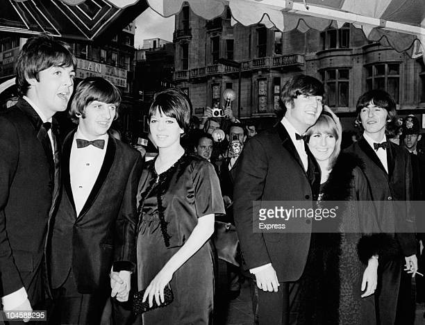 The Beatles left to right Paul McCartney Ringo Starr with his wife Maureen John Lennon with wife Cynthia and George Harrison pose for photographers...