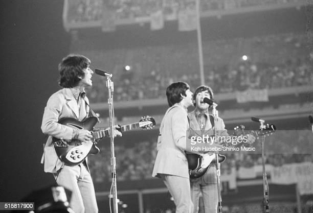 The Beatles live at Shea Stadium, New York, August 23, 1966. L-R George Harrison , Paul McCartney and John Lennon.
