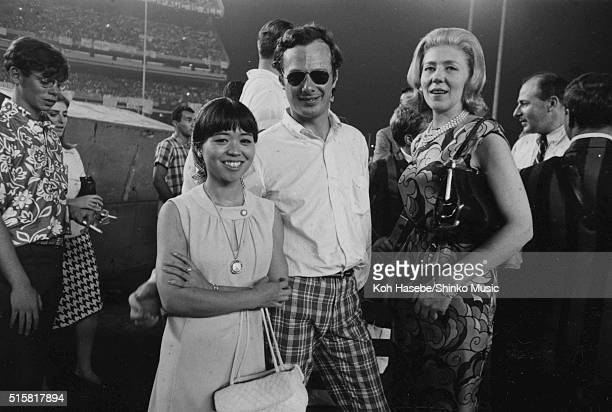 The Beatles' manager Brian Epstein poses with Japanese music journalist Rumiko Hoshika while the band perform at Shea Stadium, New York, August 23,...