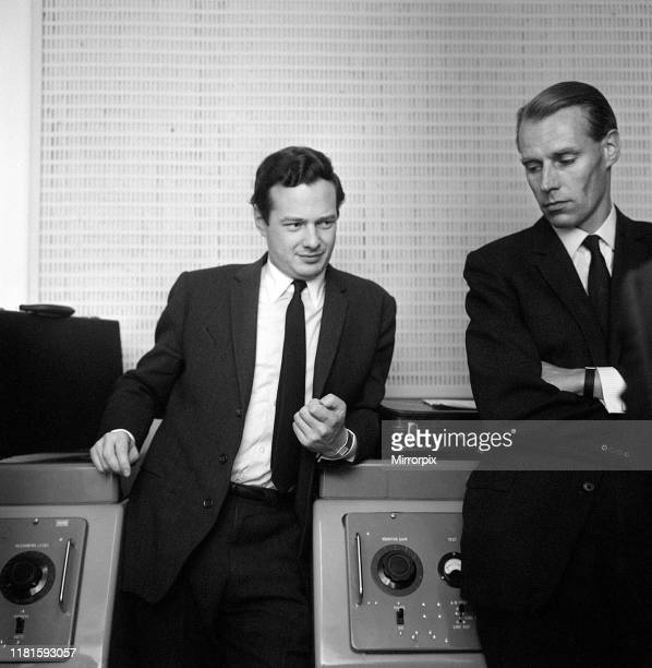 The Beatles manager Brian Epstein taken at the EMI Studios at Abbey Road St John's Wood seen with the group's recording producer George Martin....