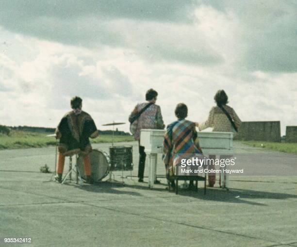 The Beatles mime to the song 'I Am The Walrus' while filming for surreal comedy television film 'Magical Mystery Tour' West Malling Air Station in...