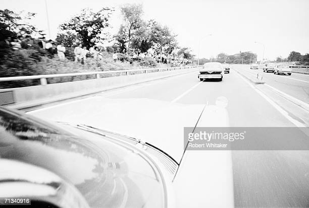 The Beatles motorcade passing through Tokyo enroute to perform at the Budokan Hall 1966
