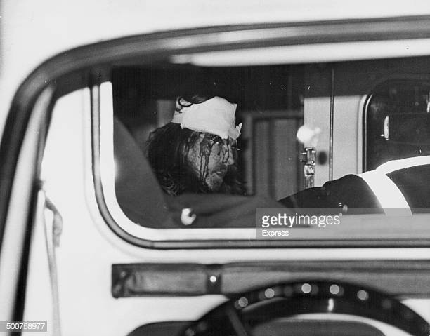 'The Beatles' musician George Harrison with a bandaged head following his car crash on the M4 arriving at Maidenhead Hospital England February 29th...