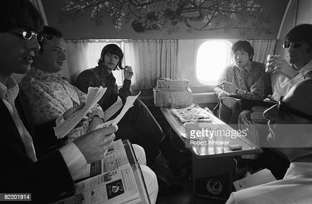 The Beatles on a Japan Airlines flight from Hong Kong to Manila during their final world tour, 3rd July 1966. Clockwise from left: George Harrison ,...