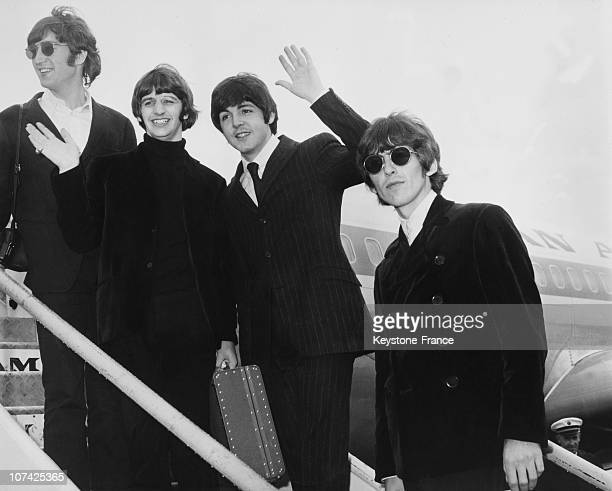 The Beatles On The Steps Of A Aircraft On 1966
