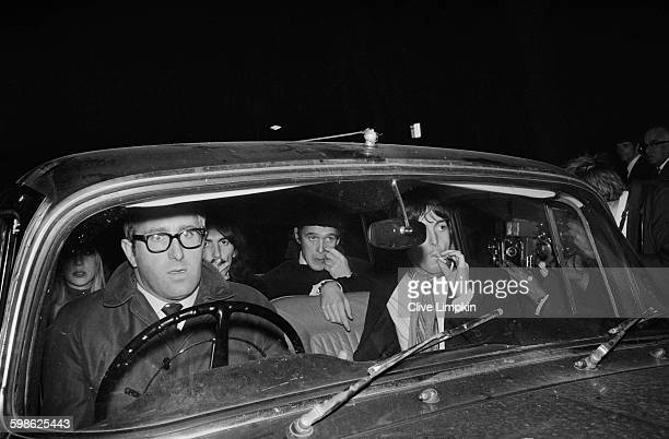 The Beatles on their way to a memorial service for their manager Brian Epstein, UK, 17th October 1967. From left to right, Patti Boyd, Mal Evans,...