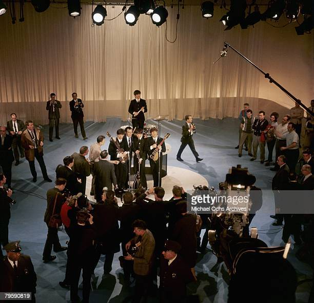 The Beatles Paul McCartney, George Harrison, John Lennon and Ringo Starr at the back with Ed Sullivan meet the press as they rehearse for their...