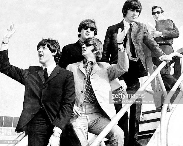 The Beatles Paul McCartney Ringo Starr John Lennon and George Harrison followed by their manager Brian Epstein arriving in New York City for their...