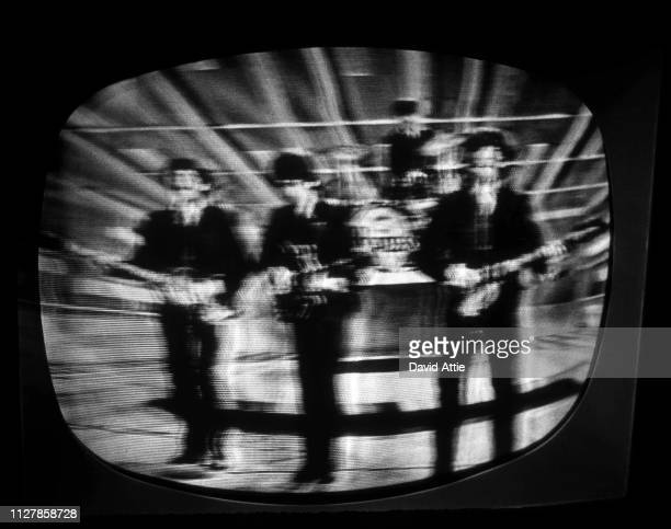 The Beatles perform on the Ed Sullivan Show shot on a TV screen during the original broadcast on February 9 in New York City New York