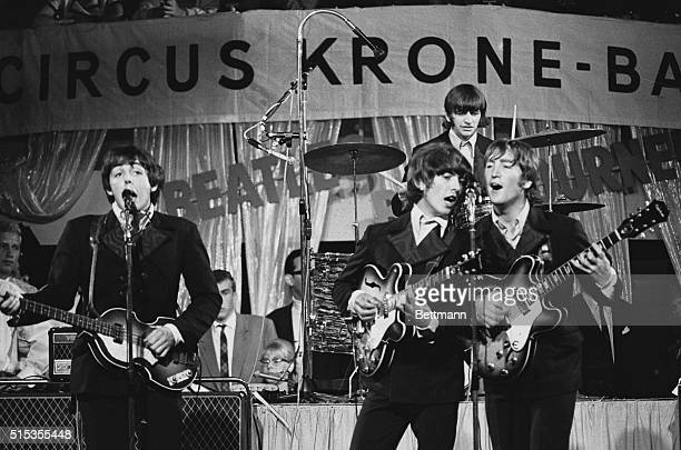 The Beatles performing at the Circus KroneBau in Munich on June 24 1966 From left to right bass guitarist Paul McCartney guitarist George Harrison...