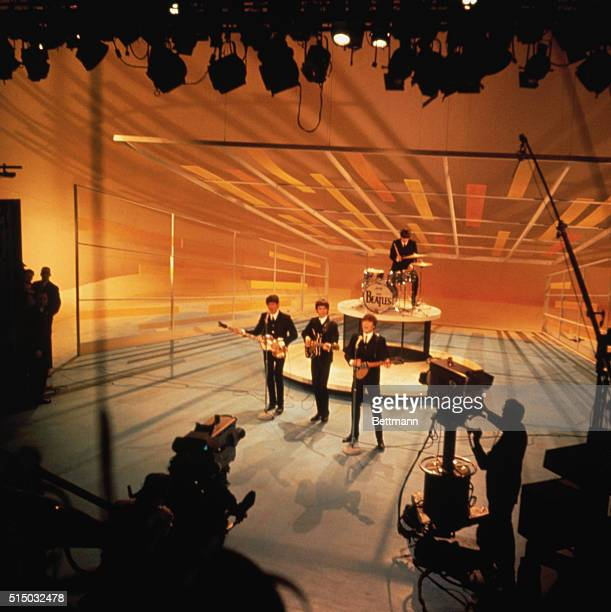 The Beatles performing during their nationwide television debut on The Ed Sullivan Show from CBS television studios in Manhattan.