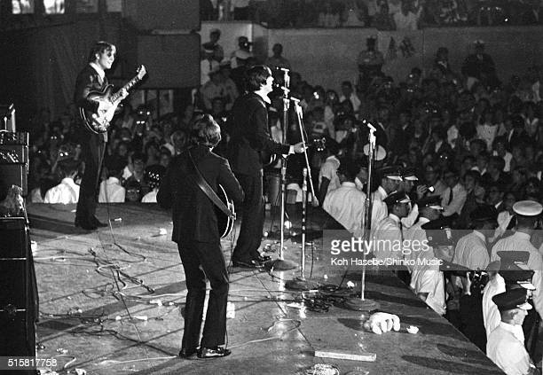 The Beatles performon stage at Chicago International Amphitheatre August 12 1966