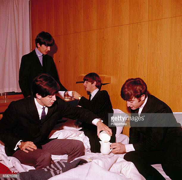 The Beatles pictured together with cups of tea in a hotel bedroom in 1963 Left to right Paul McCartney George Harrison Ringo Starr and John Lennon