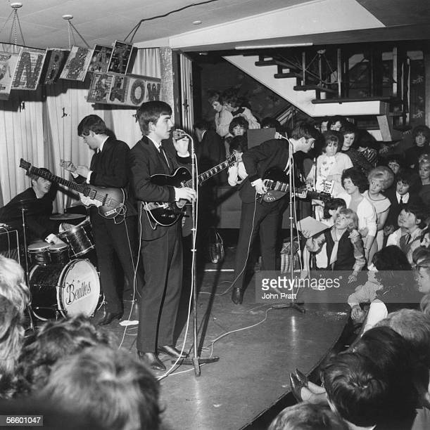 The Beatles play a concert at the Majestic Theatre in Birkenhead, Merseyside, April 1963.