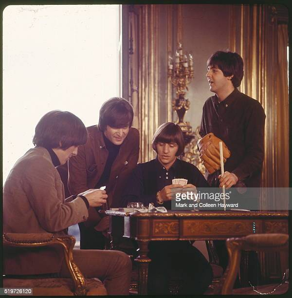 The Beatles play cards during a scene from the film 'Help' Cliveden house United Kingdom May 1965 LR George Harrison John Lennon Ringo Starr Paul...