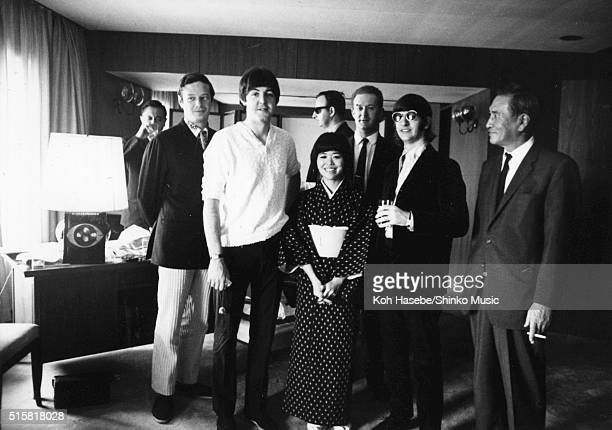 The Beatles pose during an interview for Japanese music magazine 'Music Life' Tokyo Hilton Hotel Japan July 2 1966 Manager Brian Epstein stands with...