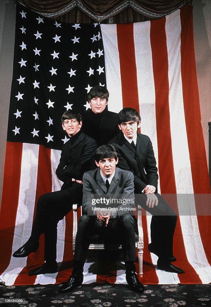 The Beatles Pose For A Portrait In Front Of An American Flag New York City