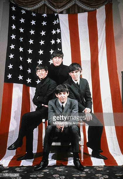 The Beatles pose for a portrait in front of an American Flag, New York City, 1964. Clockwise from top: John Lennon , George Harrison , Paul McCartney...