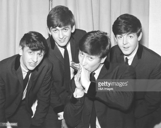 The Beatles pose for an eraly group portrait, backstage, Ringo Starr, George Harrison, John Lennon , Paul McCartney, 1962.
