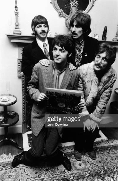 The Beatles pose for the press holding the cover of their newly completed album 'Sergeant Pepper's Lonely Hearts Club Band' at the press launch for...