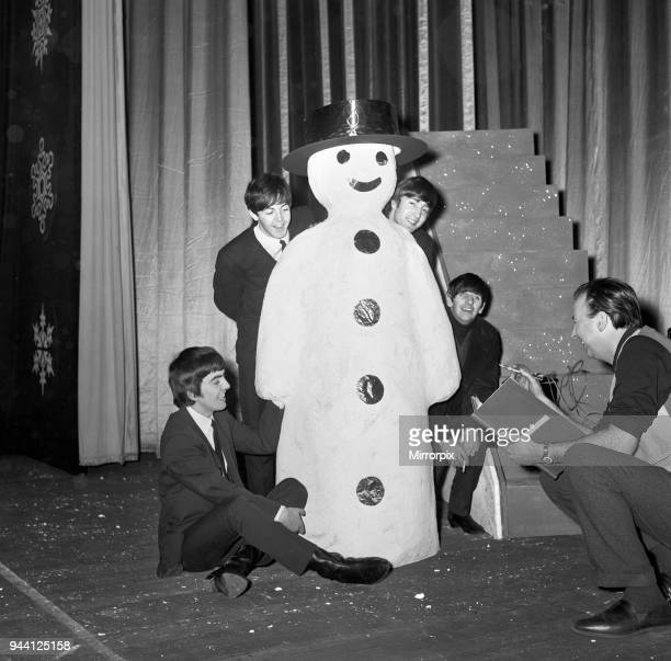 The Beatles pose with a Snowman as they take a break from rehearsals at the Astoria Cinema Finsbury Park London 19th December 1963 Preparations ahead...