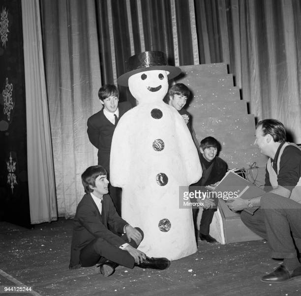 The Beatles pose with a Snowman, as they take a break from rehearsals at the Astoria Cinema, Finsbury Park, London, 19th December 1963. Preparations...