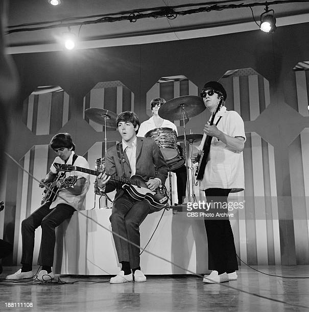 The Beatles rehearse at the Deauville Hotel Miami Beach Florida for THE ED SULLIVAN SHOW From left George Harrison Paul McCartney Ringo Starr and...