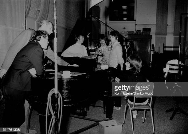 The Beatles rehearsing Paul McCartney's song 'The Fool On The Hill' in Studio 2 at EMI Studios Abbey Road London September 25 1967 LR road manager...