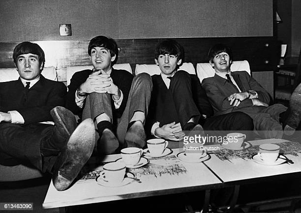 The Beatles relax before performing at the Royal Command Variety Performance at the Prince of Wales Theatre in London