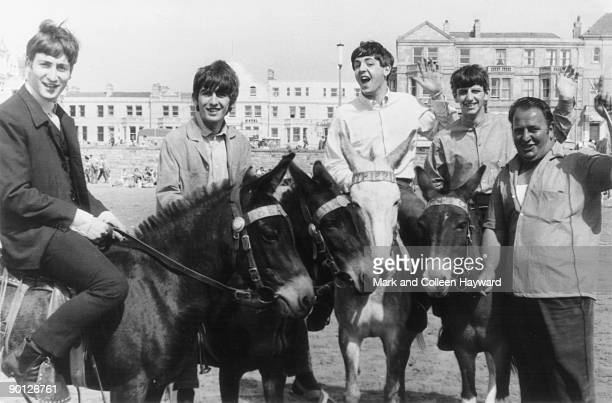 The Beatles ride donkeys on a beach in WestonsuperMare before a concert 22nd July 1963 The man on the right is the donkeys' owner