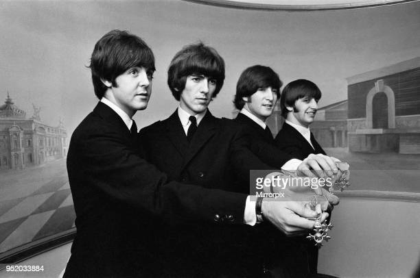 The Beatles show off their MBE medals after the royal investiture at Buckingham Palace London Tuesday 26th October 1965 The Beatles each is now a...