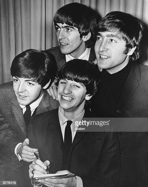 The Beatles clockwise from top George Harrison John Lennon Ringo Starr Paul McCartney signing autographs at their first press reception in Miami
