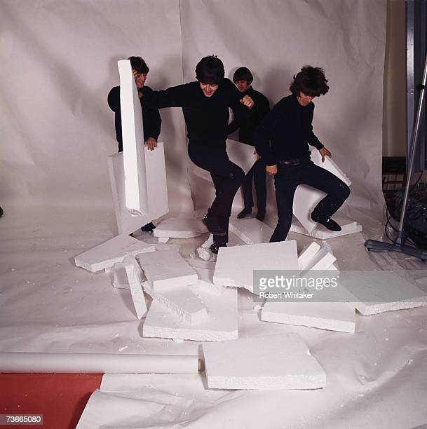 The Beatles smashing the polystyrene set after a photo shoot in a studio in Hampstead London December 1965 Left to right John Lennon Paul McCartney...