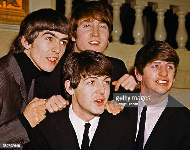 The Beatles smiling together From left to right George Harrison John Lennon Paul McCartney and Ringo Starr