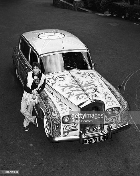 The Beatles star John Lennon shows off his psychedelic Rolls Royce circa 1967
