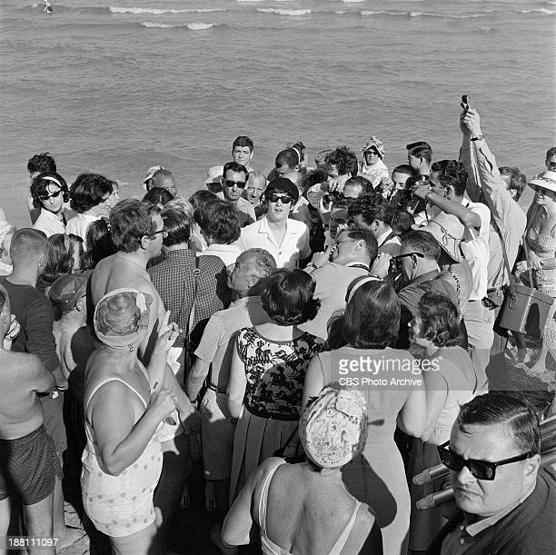 The Beatles surrounded by people at Miami Beach Florida The Band was in Florida to appear on THE ED SULLIVAN SHOW at the Deauville Hotel John Lennon...