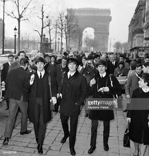 The BEATLES walking down the ChampsElysees Paris before their concert at the Olympia Theatre