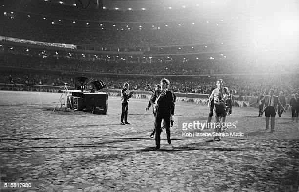 The Beatles walking to the stage before the last show of their final tour at Candlestick Park San Francisco California August 29 1966